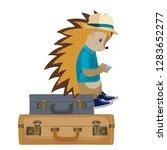 hedgehog tourist. sits on a... | Shutterstock .eps vector #1283652277