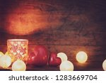 red heart and candle surrounded ... | Shutterstock . vector #1283669704