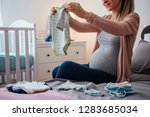 pregnant young woman holding... | Shutterstock . vector #1283685034