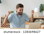euphoric young man celebrating... | Shutterstock . vector #1283698627