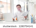 creative businessman with...   Shutterstock . vector #1283704141