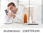 mid adult businessman receiving ...   Shutterstock . vector #1283704144