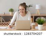 smiling woman wear headset... | Shutterstock . vector #1283704207