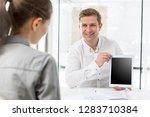 creative businessman showing...   Shutterstock . vector #1283710384