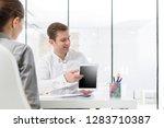 mid adult businessman showing...   Shutterstock . vector #1283710387