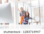 businesswoman pushing playful...   Shutterstock . vector #1283714947
