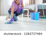young woman washing floor with... | Shutterstock . vector #1283727484