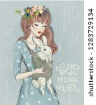 young woman with a rabbit | Shutterstock .eps vector #1283729134