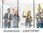 confident colleagues sticking...   Shutterstock . vector #1283739487