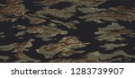 seamless tiger camouflage... | Shutterstock .eps vector #1283739907