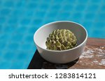 near the pool in a plate is an...   Shutterstock . vector #1283814121