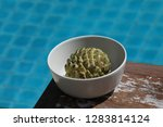 near the pool in a plate is an...   Shutterstock . vector #1283814124