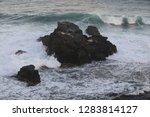 waves in a ocean swim to shore   Shutterstock . vector #1283814127