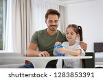 little girl with her father... | Shutterstock . vector #1283853391