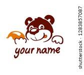 logo  character. bear eats...   Shutterstock .eps vector #1283857087