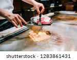 chef cook beef steak for the... | Shutterstock . vector #1283861431