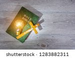 glow illuminating the holy bible | Shutterstock . vector #1283882311