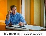 businessman talking on cell... | Shutterstock . vector #1283913904