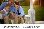 mature man shows young sons his ... | Shutterstock . vector #1283915704