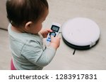the child controls the robot... | Shutterstock . vector #1283917831
