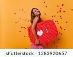 tanned brunette girl enjoying... | Shutterstock . vector #1283920657