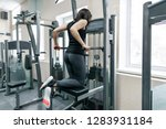 young woman doing exercises for ... | Shutterstock . vector #1283931184