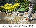 cobble brick driveway pressure...   Shutterstock . vector #1283941297