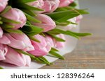 pink tulips in paper pack on... | Shutterstock . vector #128396264