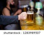 beer mug on bar counter...   Shutterstock . vector #1283989507