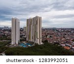 apartment tower and the large... | Shutterstock . vector #1283992051