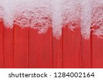 frost on red woden wall | Shutterstock . vector #1284002164
