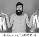 male shopaholic with long beard ... | Shutterstock . vector #1284011104