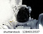 astronaut in outer space.... | Shutterstock . vector #1284013537