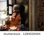 buddha statuette with different ... | Shutterstock . vector #1284020404