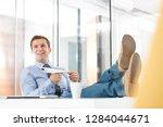 happy businessman holding paper ...   Shutterstock . vector #1284044671