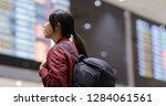 woman check the flight number... | Shutterstock . vector #1284061561