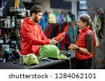 young woman buying some sports... | Shutterstock . vector #1284062101
