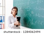 female math teacher in front of ... | Shutterstock . vector #1284062494