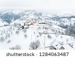 winter in pestera village in... | Shutterstock . vector #1284063487