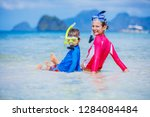 cute happy girl and boy with...   Shutterstock . vector #1284084484