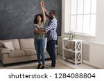happy afro american couple... | Shutterstock . vector #1284088804
