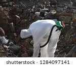 removal asbestos. worker with... | Shutterstock . vector #1284097141