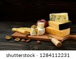 cheese plate  parmesan  cheddar ...   Shutterstock . vector #1284112231
