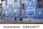 pavement next to the wall of... | Shutterstock . vector #1284118477