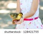 little duck in hands of the... | Shutterstock . vector #128421755