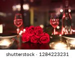 red roses and candle lights in... | Shutterstock . vector #1284223231