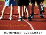children on athletic running... | Shutterstock . vector #1284225517