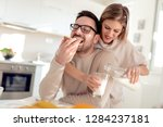young happy couple sitting in... | Shutterstock . vector #1284237181