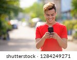 happy young asian man using... | Shutterstock . vector #1284249271