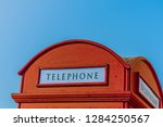 the curved roof of a red... | Shutterstock . vector #1284250567